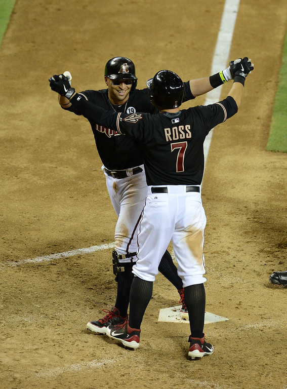 . PHOENIX, AZ - JULY 06:  Martin Prado #14 celebrates a two run home run with teammate Cody Ross #7 against the Colorado Rockies at Chase Field on July 6, 2013 in Phoenix, Arizona.  (Photo by Norm Hall/Getty Images)