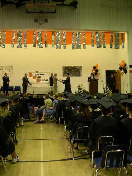 receiving the diploma from Mom