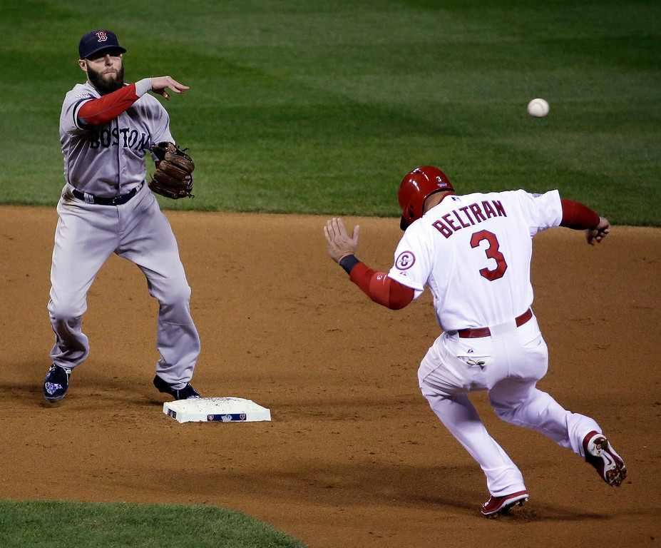 . Boston Red Sox\'s Dustin Pedroia throws over St. Louis Cardinals\' Carlos Beltran (3) to turn a double play on a ball hit by Allen Craig during the second inning of Game 5 of baseball\'s World Series Monday, Oct. 28, 2013, in St. Louis. (AP Photo/David J. Phillip)