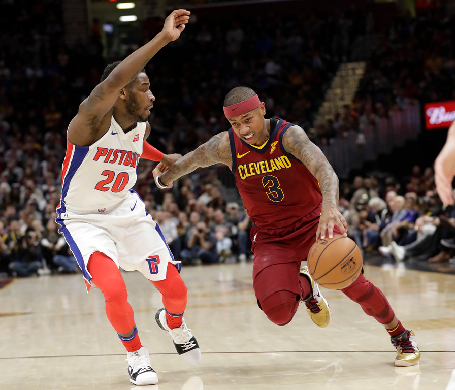 . Cleveland Cavaliers\' Isaiah Thomas (3) drives past Detroit Pistons\' Dwight Buycks (20) in the first half of an NBA basketball game, Sunday, Jan. 28, 2018, in Cleveland. (AP Photo/Tony Dejak)