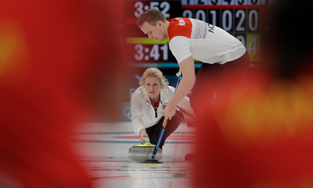 . Norway\'s Kristin Skaslien, left, and Magnus Nedregotten prepares to throw the stone during their mixed doubles curling match against China at the 2018 Winter Olympics in Gangneung, South Korea, Sunday, Feb. 11, 2018. Norway won. (AP Photo/Aaron Favila)