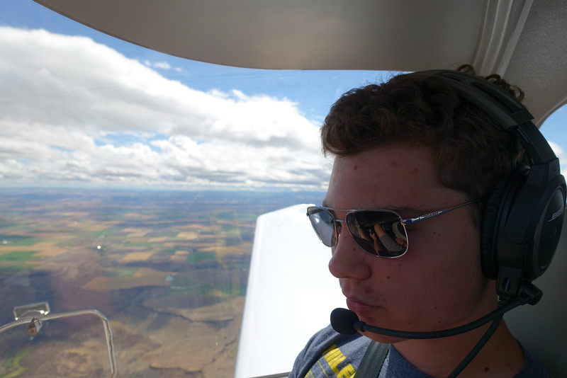 """After some instruction Ethan serves as """"autopilot.""""  Note the concentration apparent on his face."""