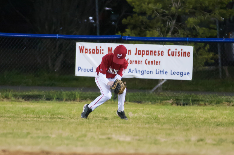 Sam fielding the ball in center field in the bottom of the 2nd inning. The As score two runs. 0-3. The Nationals are now 2-2 for the season after a 1-9 loss to the Athletics. 2012 Arlington Little League Baseball, Majors Division. Nationals vs Athletics (24 Apr 2012) (Image taken by Patrick R. Kane on 24 Apr 2012 with Canon EOS-1D Mark III at ISO 3200, f2.8, 1/250 sec and 200mm)