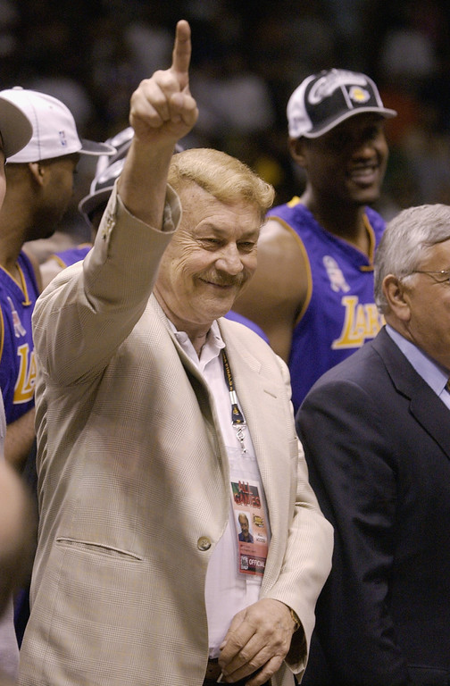 . EAST RUTHERFORD, NJ - JUNE 12:  Lakers Owner Dr. Jerry Buss celebrates after defeating the New Jersey Nets in Game four of the 2002 NBA Finals at Continental Airlines Arena in East Rutherford, New Jersey on June 12, 2002. The Lakers won 112-106 to sweep the series and take the 2002 championship title.  NOTE TO USER: User expressly acknowledges and agrees that, by downloading and/or using this Photograph, User is consenting to the terms and conditions of the Getty Images License Agreement.  Mandatory copyright notice: Copyright 2002 NBAE  (Photo by Ezra Shaw/Getty Images)