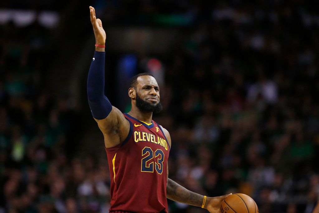 . Cleveland Cavaliers forward LeBron James reacts as he dribbles up court during the second quarter of Game 1 of the NBA basketball Eastern Conference Finals against the Boston Celtics, Sunday, May 13, 2018, in Boston. (AP Photo/Michael Dwyer)