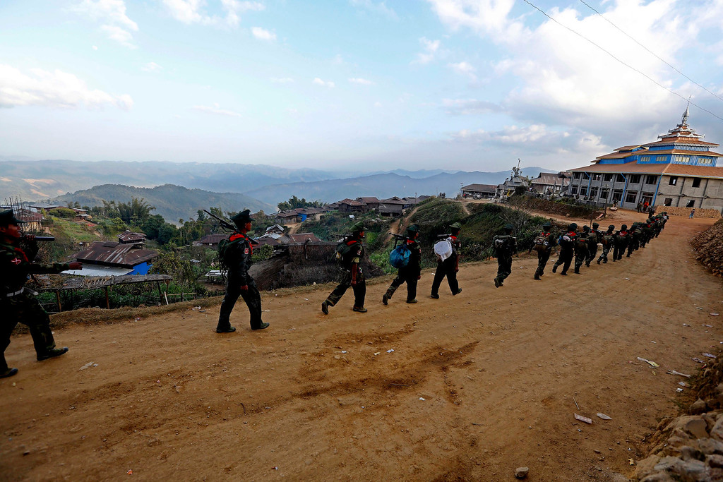 . Soldiers of the Ta-ang National Liberation Army (TNLA), one of the ethnic rebel groups walk, in Homain village, Nansam Township, Northern Shan State, Myanmar, 13 January 2014.   EPA/NYEIN CHAN NAING