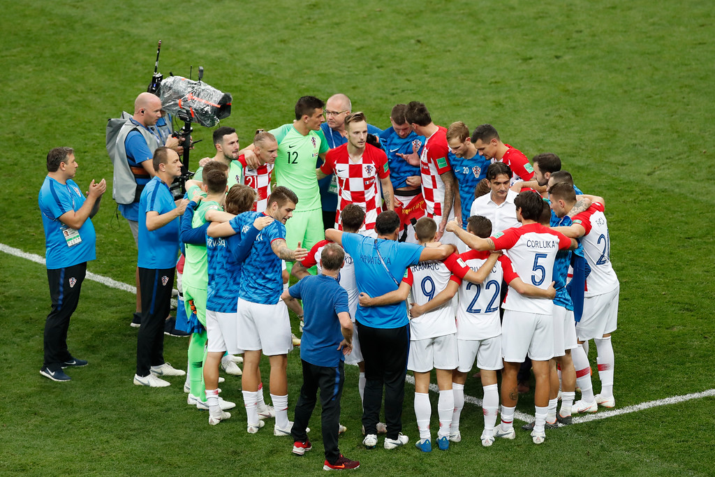 . Croatia players gather on the pitch at the end of the final match between France and Croatia at the 2018 soccer World Cup in the Luzhniki Stadium in Moscow, Russia, Sunday, July 15, 2018. (AP Photo/Rebecca Blackwell)