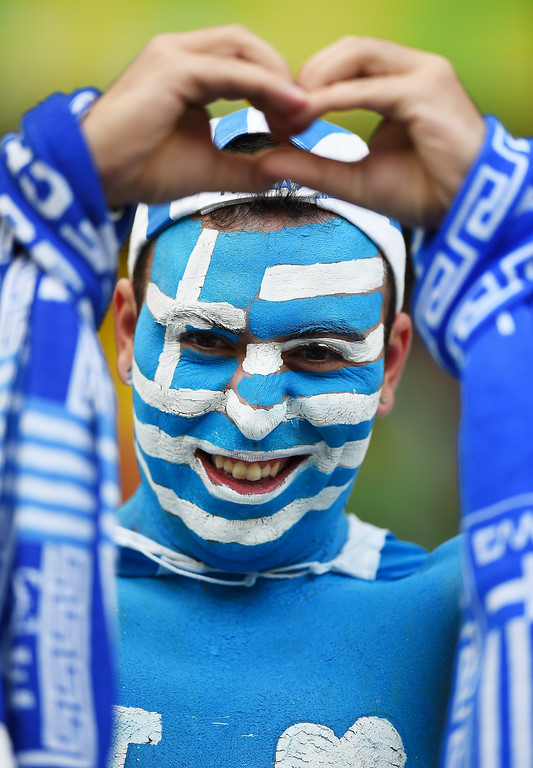 . A Greece fan enjoys the atmosphere during the 2014 FIFA World Cup Brazil Group C match between Greece and the Ivory Coast at Castelao on June 24, 2014 in Fortaleza, Brazil.  (Photo by Laurence Griffiths/Getty Images)