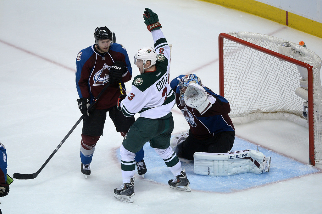 . DENVER, CO - APRIL 26: Charlie Coyle (3) of the Minnesota Wild celebrates as go-ahead 3-2 goal by teammate Kyle Brodziak (21) as Erik Johnson (6) of the Colorado Avalanche and Semyon Varlamov (1) of the Colorado Avalanche look on during the third period. The Colorado Avalanche hosted the Minnesota Wild during game five of the first round of the NHL Stanley Cup Playoffs at the Pepsi Center on Saturday, April 26, 2014. (Photo by Karl Gehring/The Denver Post)