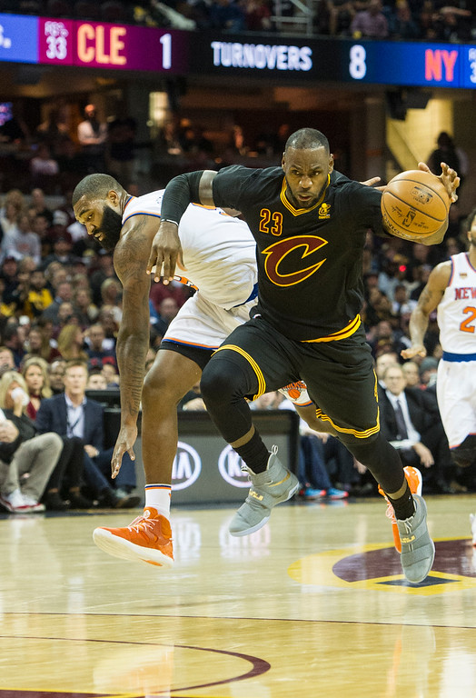. Cleveland Cavaliers\' LeBron James (23) drives past New York Knicks\' Kyle O\'Quinn during the first half of a basketball game in Cleveland, Tuesday, Oct. 25, 2016. (AP Photo/Phil Long)