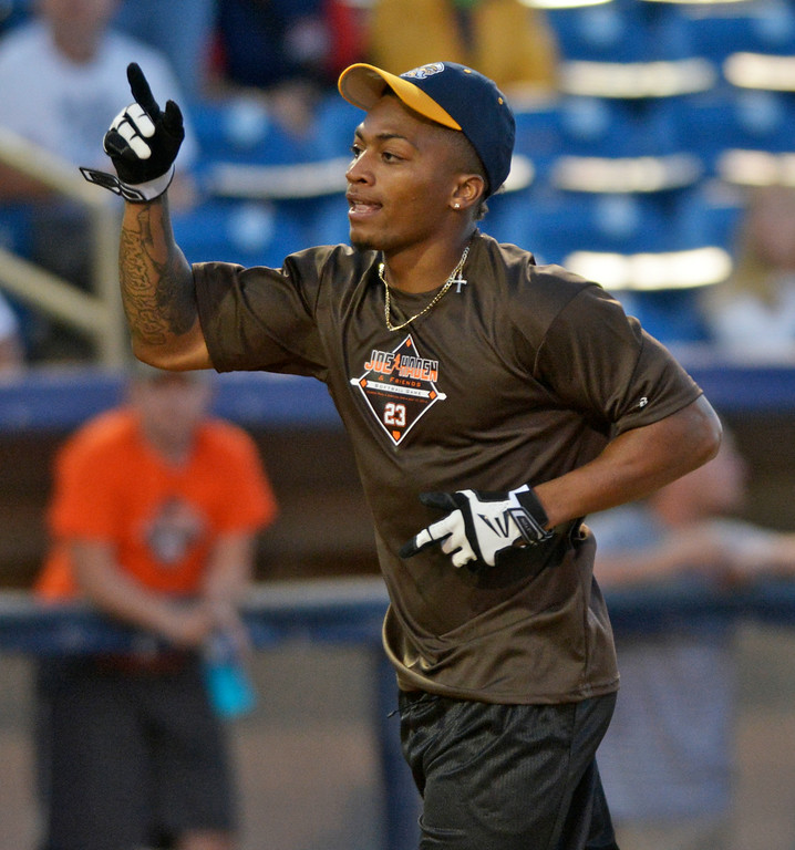 . Jeff Forman/JForman@News-Herald.com Buster Skrine celebrates his home run during the Joe Haden and Friends Softball Game July 17 at Classic Park.