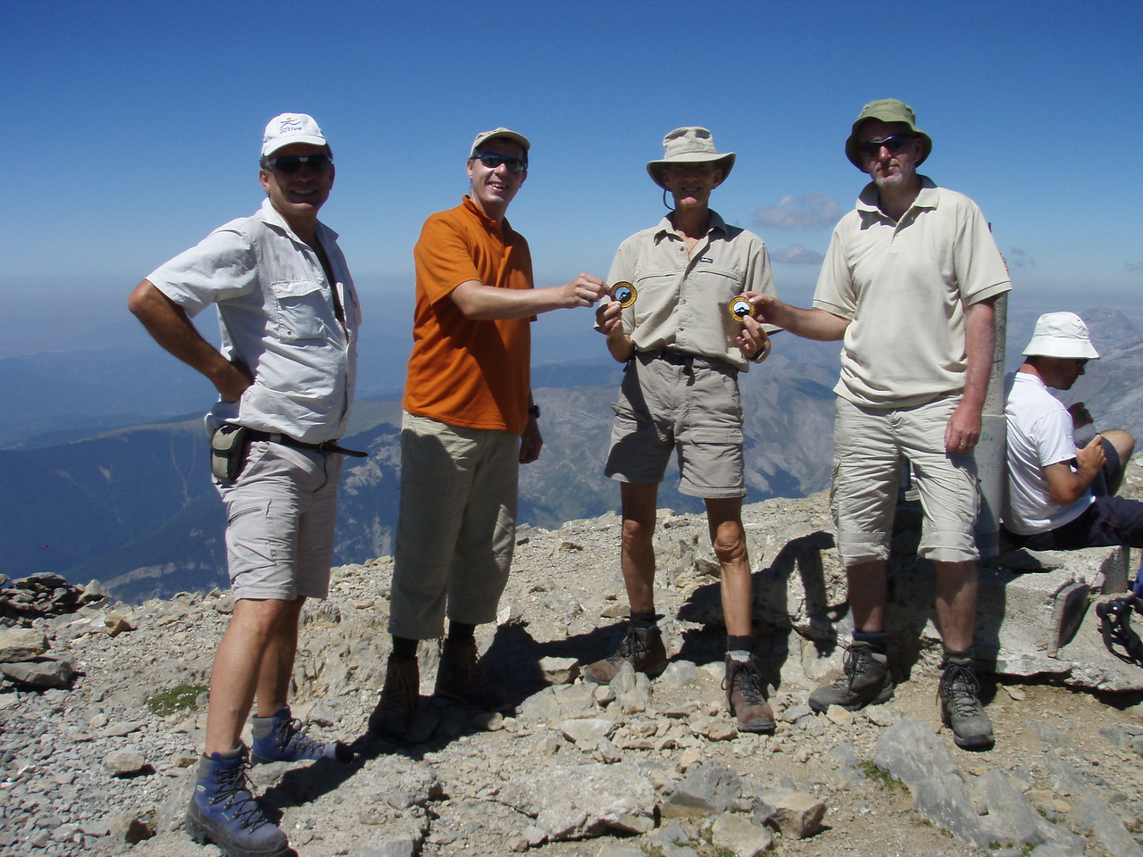 Albert and Edward receive their club badges from Vic on the summit of Pico Collarada