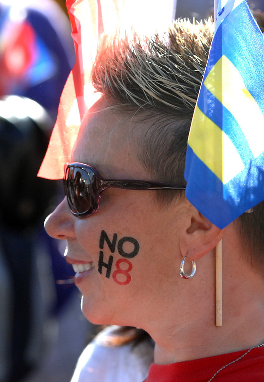 ". Michelle Lewis wears a ""NOH8\"" decall at a rally in West Hollywood to celebrate the U.S. Supreme Court\'s ruling that killed Prop 8, Wednesday, June 26, 2013. (Michael Owen Baker/L.A. Daily News)"