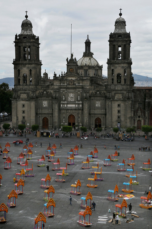. Representations of boats known as trajineras are on display in Mexico City\'s main square, the Zocalo, as part of the Day of the Dead festivities in Mexico City, Thursday, Oct. 27, 2016.  The holiday honors the dead as friends and families gather in cemeteries to decorate their loved ones\' graves and hold vigil through the night on Nov. 1 and 2. (AP Photo/Marco Ugarte)