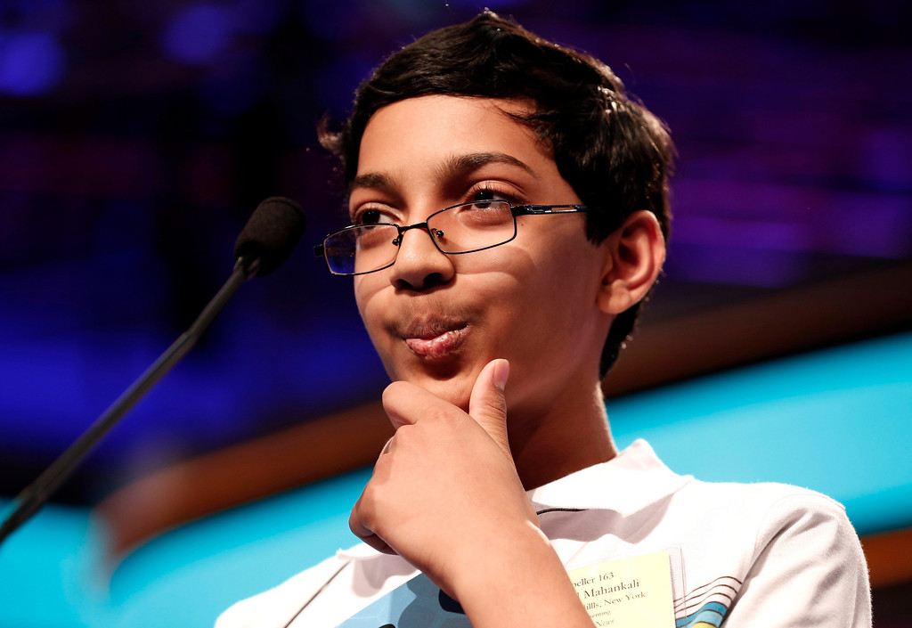 """. Arvind Mahankali of New York ponders a word on his way to winning the National Spelling Bee at National Harbor in Maryland May 30, 2013. Mahankali, a 13-year-old from Bayside Hills, New York, won the Scripps National Spelling Bee on Thursday by correctly spelling \""""knaidel,\"""" a kind of dumpling. Mahankali, a student at Nathaniel Hawthorne Middle School, had finished third in the contest twice before.  REUTERS/Kevin Lamarque"""