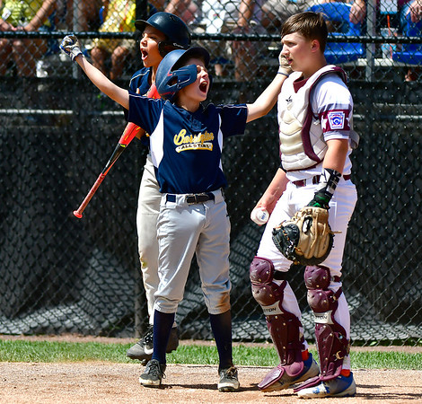 8/10/2019 Mike Orazzi | Staff Rhode Islands Barrington Little League's Cullen Crain (22) scores as New Hampshires Goffstown Junior Baseball Little League's Dillon Gaudet (42) looks on at Breen Field in Bristol, Conn., during the New England Regional Baseball Tournament.