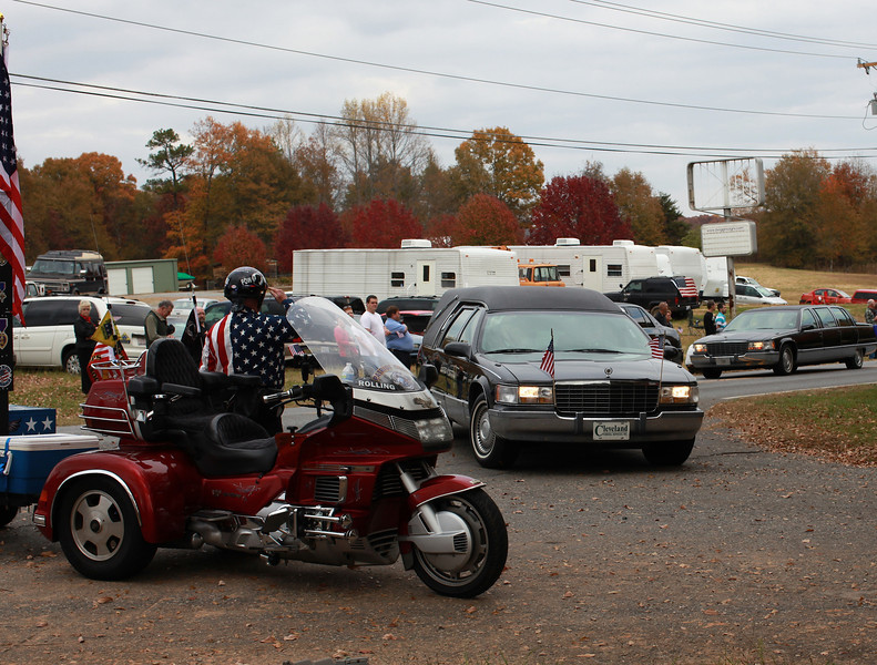 The hearse carrying Sgt. Chris Newman enters Cleveland Memorial Park where he was laid to rest Wednesday, November 9, 2011.