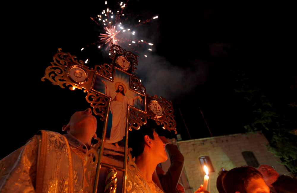 . Palestinian Christians watch fireworks during the ceremony of the Holy Fire at a Greek Orthodox church in Gaza City, Sunday, May 5, 2013. Eastern Orthodox churches celebrate Easter, the resurrection of Jesus, on Sunday. (AP Photo/Hatem Moussa)
