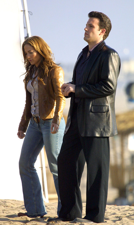 """. Actor Ben Affleck and actress/singer Jennifer Lopez film a scene on the set of \""""Gigli\"""" at Will Rodgers Beach on January 12, 2003 in Pacific Palisades, California.  (Photo by Ben-Ari Finegold/Getty Images)"""