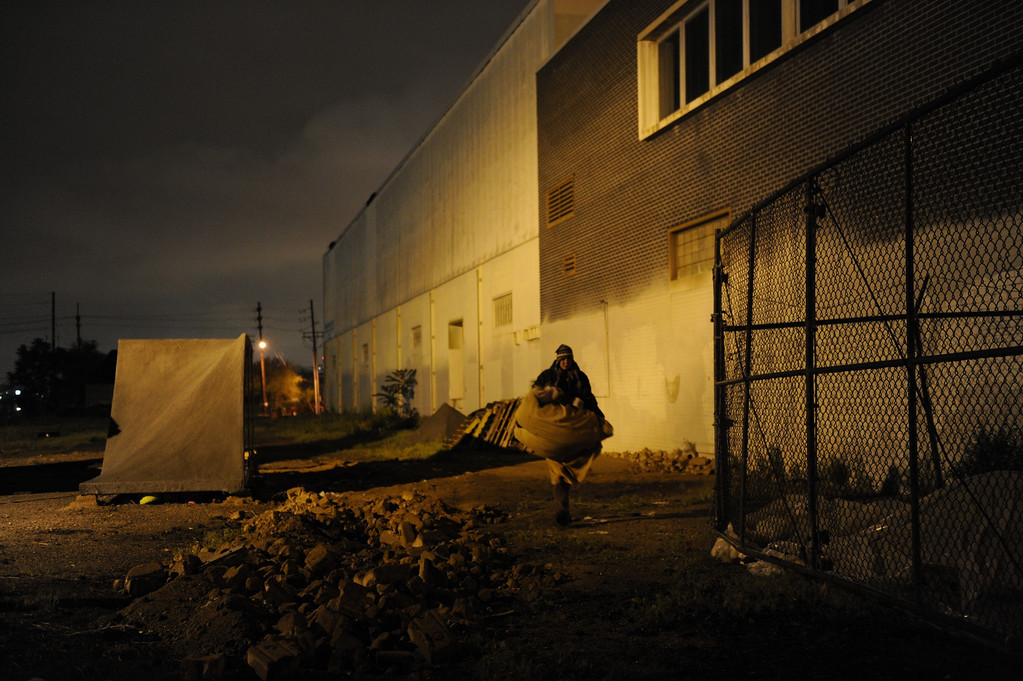 """. As darkness sets in, Angel, a heroin addict living on the streets of Denver, moves her sleeping bag to set it up next to a dumpster. On cold nights, Angel has a hard time finding a vein to shoot up. \""""I never thought I\'d end up being homeless. It\'s not something I thought would ever happen but when it happened, the first day that we were out on the street, it actually poured and I was bawling my eyes out. After that, I just kind of got used to it,\"""" Angel says. Joe Amon, The Denver Post"""