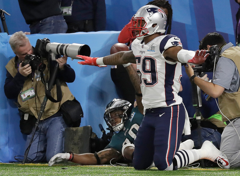 . Philadelphia Eagles\' Corey Clement, bottom, celebrates his touchdown catch behind New England Patriots\' Marquis Flowers during the second half of the NFL Super Bowl 52 football game Sunday, Feb. 4, 2018, in Minneapolis. (AP Photo/Mark Humphrey)
