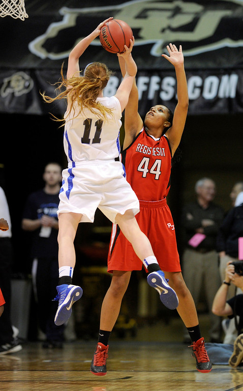 . BOULDER, CO. - MARCH 16: Falcons senior center Madison Montgomery (11) worked against Raiders center Jordan Molyneaux (44) in the second half. The Regis Jesuit High School girl\'s basketball team defeated Highlands Ranch 53-46 in the 5A championship game Saturday, March 16, 2013 at the Coors Events Center in Boulder.  (Photo By Karl Gehring/The Denver Post)