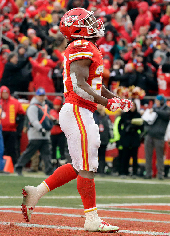 . Kansas City Chiefs running back Kareem Hunt, right, celebrates his one-yard touchdown run during the first half of an NFL wild-card playoff football game against the Tennessee Titans in Kansas City, Mo., Saturday, Jan. 6, 2018. (AP Photo/Charlie Riedel)