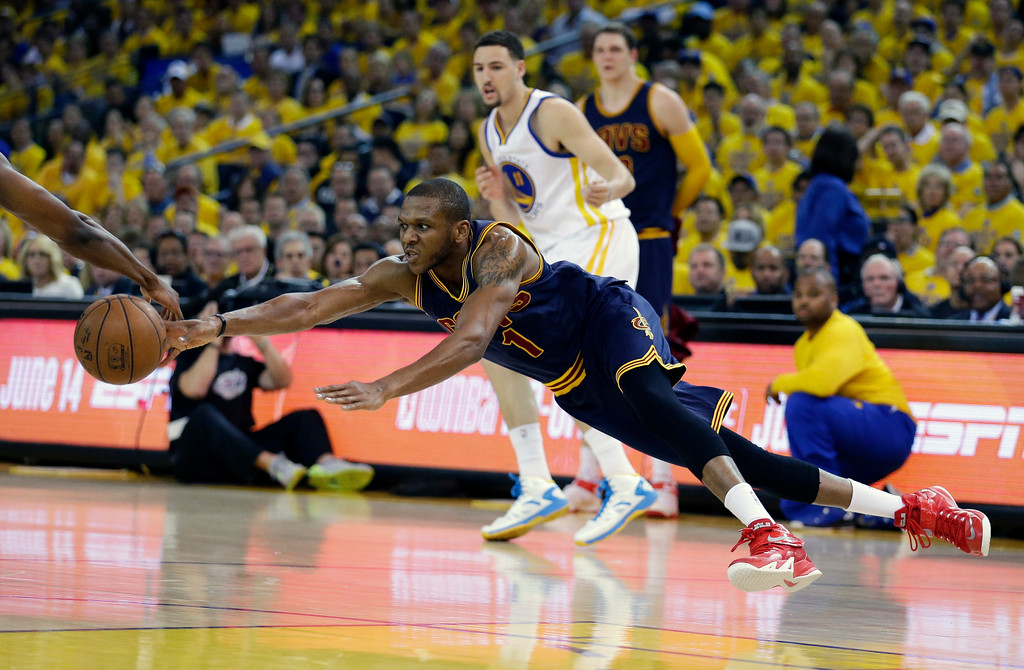 . Cleveland Cavaliers forward James Jones (1) reaches for a loose ball during the first half of Game 2 of basketball\'s NBA Finals against the Golden State Warriors in Oakland, Calif., Sunday, June 7, 2015. (AP Photo/Ben Margot)