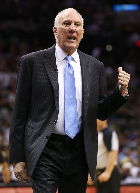 . Head coach Gregg Popovich of the San Antonio Spurs calls out in the first quarter while taking on the Oklahoma City Thunder in Game Two of the Western Conference Finals during the 2014 NBA Playoffs at AT&T Center on May 21, 2014 in San Antonio, Texas.   (Photo by Ronald Martinez/Getty Images)