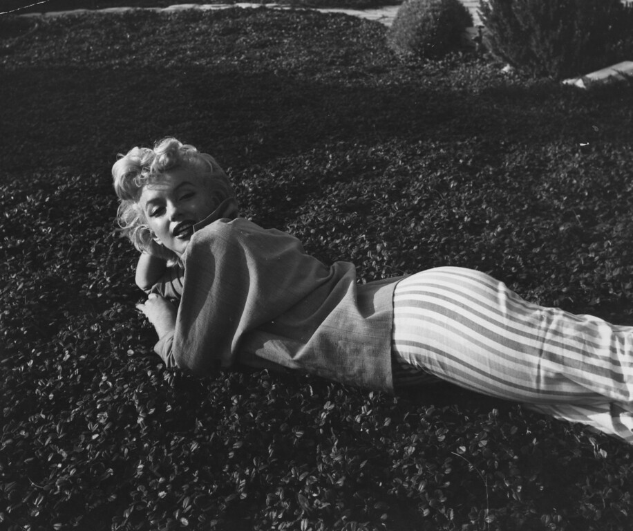 . 1954:  American film star Marilyn Monroe (Norma Jean Mortenson or Norma Jean Baker, 1926 - 1962), relaxing on the grass in one of her over the shoulder poses.  (Photo by Baron/Getty Images)