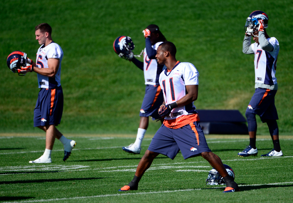 . After warm-ups, Jordan Norwood (11) heads to the practice field with fellow wide receivers. The Denver Broncos football team gets in their final day of practice during training camp at Dove Valley  on Friday, Aug. 15, 2014. (Photo by Kathryn Scott Osler/The Denver Post)