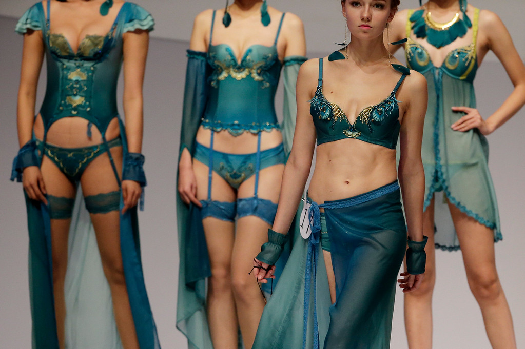 . Catwalk models present creations for Ordifen Cup China Lingerie Design Contest during China Fashion Week in Beijing, China Wednesday, Oct. 29, 2014. (AP Photo/Andy Wong)