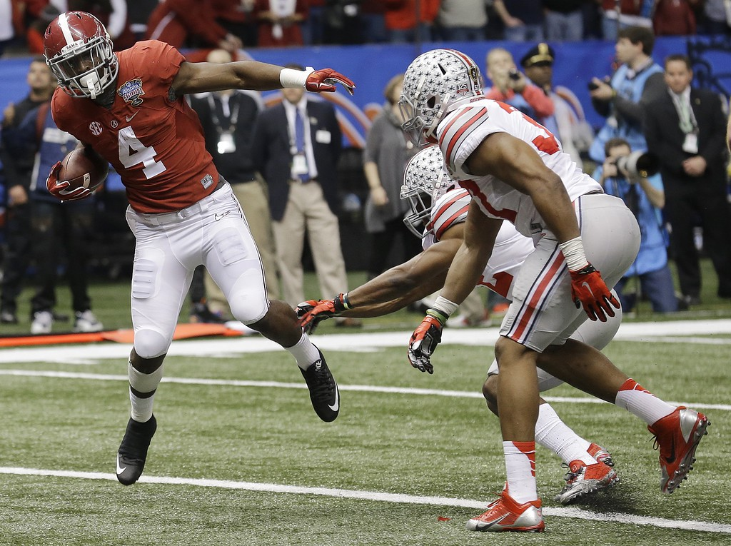 . Alabama running back T.J. Yeldon (4) runs into the end zone for a touchdown against Ohio State in the first half of the Sugar Bowl NCAA college football playoff semifinal game, Thursday, Jan. 1, 2015, in New Orleans. (AP Photo/Bill Haber)