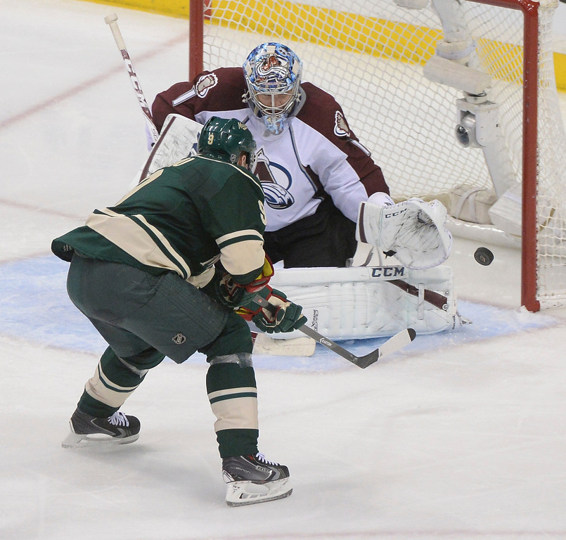 . Minnesota center Mikko Koivu (9) fired a shot at Colorado goalie Semyon Varlamov (1) in the second period. The Minnesota Wild hosted the Colorado Avalanche at the Xcel Energy Center in St. Paul Monday night, April 21, 2014. (Photo by Karl Gehring/The Denver Post)