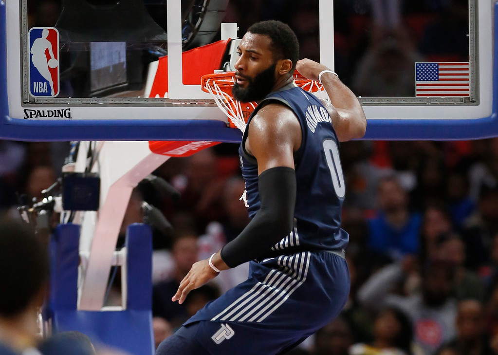 . Detroit Pistons center Andre Drummond (0) hangs on the rim after dunking the ball against the Cleveland Cavaliers during the second half of an NBA basketball game Tuesday, Jan. 30, 2018, in Detroit. Drummond scored 21 points and grabbed 22 rebounds in the Pistons 125-114 win. (AP Photo/Duane Burleson)