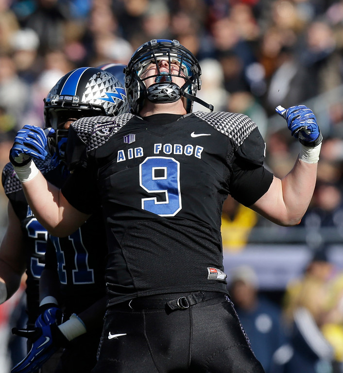 . Air Force linebacker Alex Means (9) celebrates a sack against the Rice during the first half of the Armed Forces Bowl NCAA college football game Saturday, Dec. 29, 2012, in Fort Worth, Texas. (AP Photo/LM Otero)