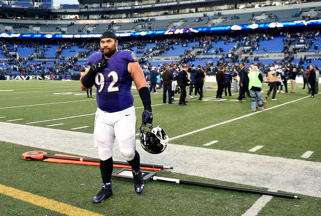 . Baltimore Ravens defensive end Haloti Ngata walks off the field after an NFL football game against the San Diego Chargers, Sunday, Nov. 30, 2014, in Baltimore. (AP Photo/Nick Wass)