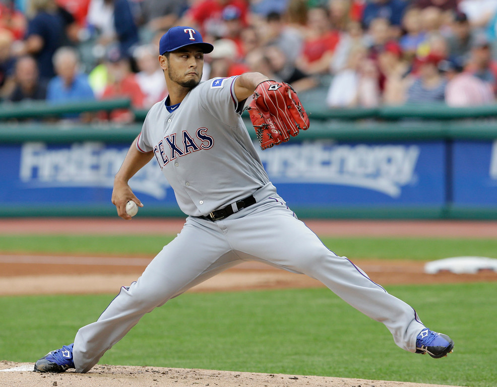 . Texas Rangers starting pitcher Yu Darvish delivers in the first inning of a baseball game against the Cleveland Indians, Wednesday, June 28, 2017, in Cleveland. (AP Photo/Tony Dejak)