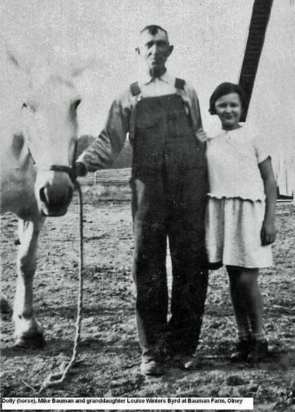 Mike Bauman and granddaughter Louise Winters Byrd with Dolly the horse.jpg
