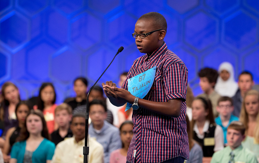 ". Tajaun Gibbison, 13, of Mandeville, Jamaica, uses his palm to write and spell his word ""charcuterie\"" during the finals of the Scripps National Spelling Bee, Thursday, May 29, 2014, at National Harbor in Oxon Hill, Md. Gibbison, spelled his word correct.  (AP Photo/Manuel Balce Ceneta)"