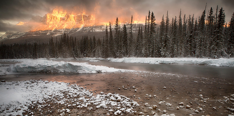 Bow river fog and fiery sunrise on Castle Mountain, Banff National Park