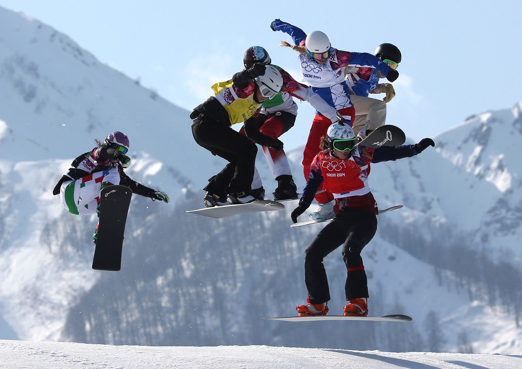 . Czech Republic\'s Eva Samkova, bottom right, leads the field in the women\'s snowboard cross final at the Rosa Khutor Extreme Park, at the 2014 Winter Olympics, Sunday, Feb. 16, 2014, in Krasnaya Polyana, Russia. Samkova went on to win the gold medal. The other boarders are, from left, Italy\'s Michela Moioli, Bulgaria\'s Alexandra Jekova, Canada\'s Dominique Maltais, France\'s Chloe Trespeuch, and United States\' Faye Gulini. (AP Photo/Luca Bruno)