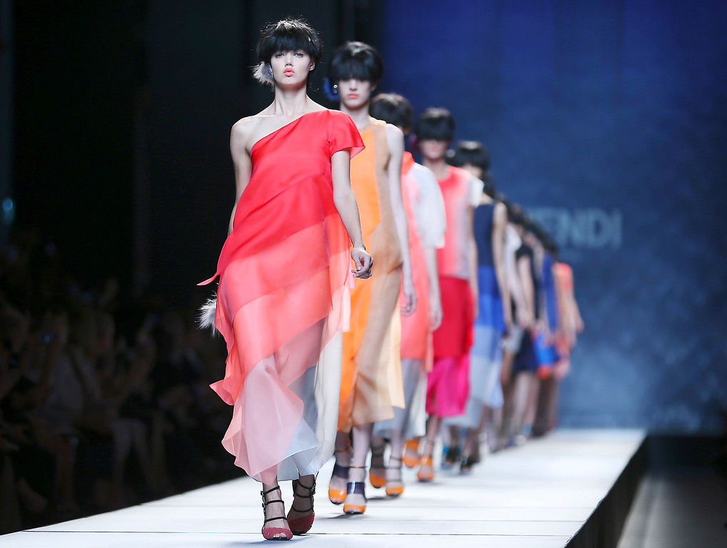 . Models wear creations for Fendi  women\'s Spring-Summer 2014 collection, part of the Milan Fashion Week, unveiled in Milan, Italy, Thursday, Sept. 19, 2013. (AP Photo/Antonio Calanni)