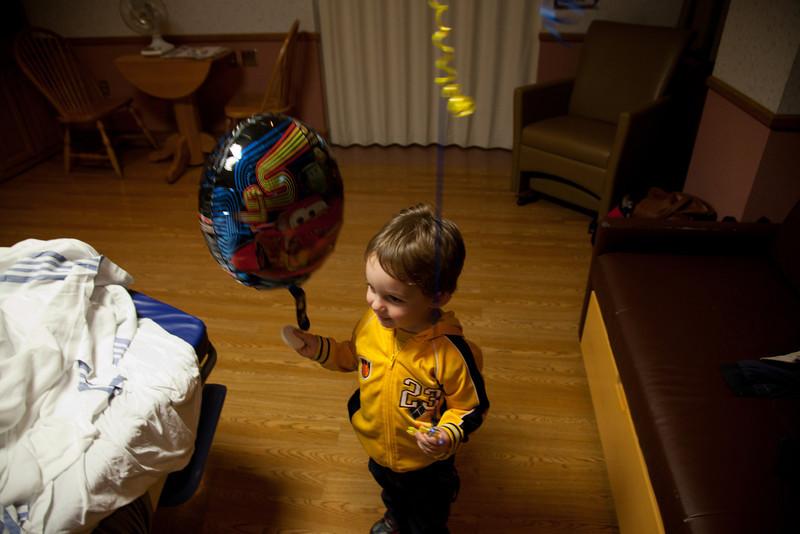 Hunter brings Henry a balloon on his birthday at Sarah Bush Lincoln Hospital in Mattoon, Illinois on November 14,  2011. (Jay Grabiec)