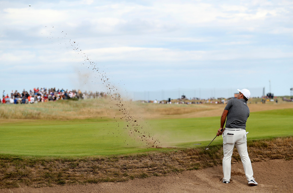 . Francesco Molinari of Italy plays out of a bunker on the 6th green during the final round for the 147th British Open Golf championships in Carnoustie, Scotland, Sunday, July 22, 2018. (AP PhotoPeter Morrison)