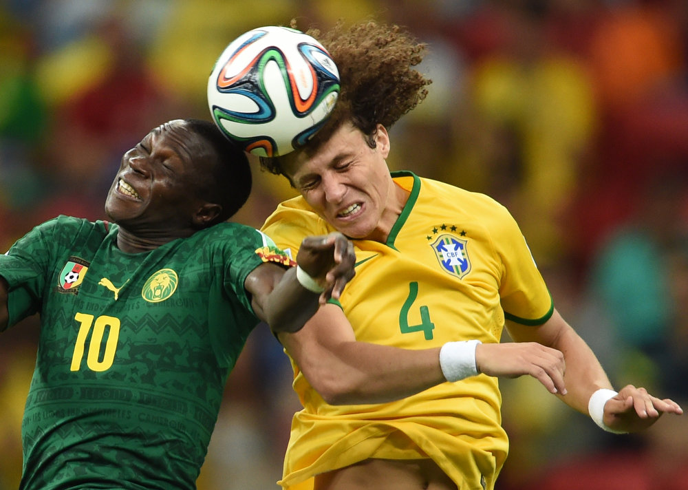 . Brazil\'s defender David Luiz (R) vies with Cameroon\'s forward Vincent Aboubakar during a Group A football match between Cameroon and Brazil at the Mane Garrincha National Stadium in Brasilia during the 2014 FIFA World Cup on June 23, 2014.   XAVIER MARIT/AFP/Getty Images