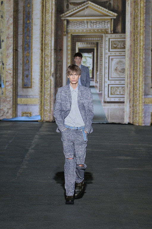 . A model walks the runway during the Krisvanassche show as part of the Paris Fashion Week Menswear Spring/Summer 2015 on June 27, 2014 in Paris, France.  (Photo by Francois Durand/Getty Images)