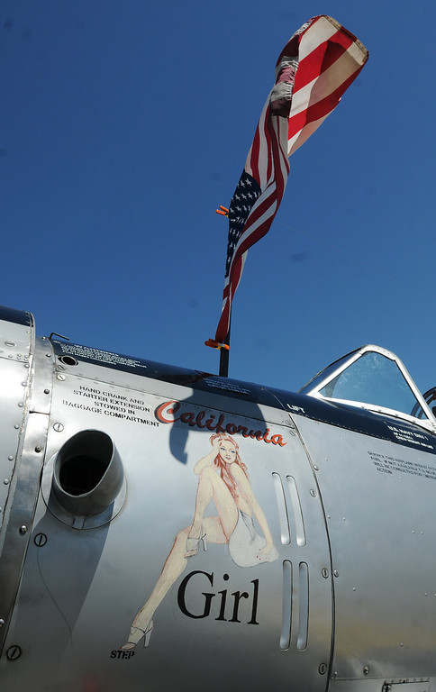 . Jim Bobel/JBobel@MorningJournal.com California Girl nose art on the Navy trainer SVN-1 at the Discover Aviation Air Show at the Lorain County Regional Airport.