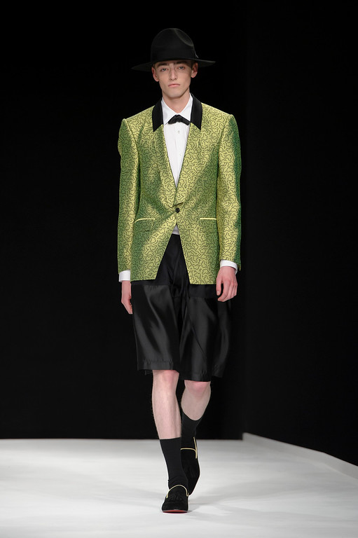 . A model wears a creation by designer E. Tautz during London Men\'s spring summer fashion collections 2014, in London, Tuesday, June 18, 2013. (Photo by Jonathan Short/Invision/AP)