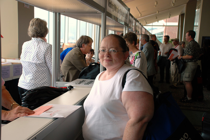 Helen Nelson smiling at the camera during registration.
